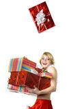 Santa girl with presents on white background Stock Photo