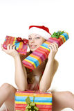 Santa girl with presents on white background Stock Photography