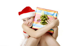 Santa girl with presents on white background Royalty Free Stock Photos