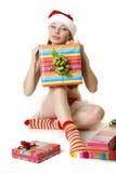 Santa girl with presents on white background Stock Photos