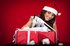 Santa girl, presents, wrapping, ribbon Stock Images