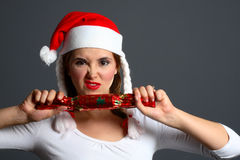 Santa girl pulling cracker Stock Photos