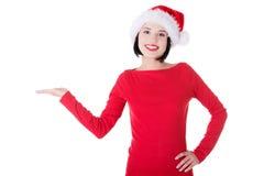 Santa Girl que presenta su producto Imagen de archivo libre de regalías