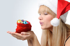 Santa Girl with a red bag Christmas toys royalty free stock image