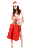 Santa girl with red bag and present. Young Santa girl with red bag and present Stock Photo