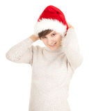Santa girl in red Christmas hat Stock Photos