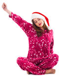 Santa girl relaxing by stretching her right hand Stock Image