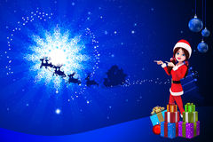 Santa girl with shadow of sleigh Stock Image