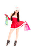 Santa girl with shopping bags Royalty Free Stock Photo