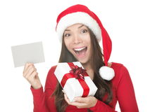 Santa girl showing blank sign Stock Image