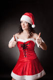 Santa girl shows OK royalty free stock photo