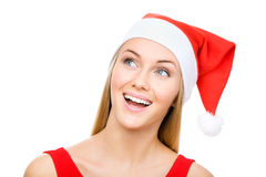 Santa girl shows a white space Royalty Free Stock Photos