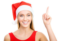 Santa girl shows a white space Royalty Free Stock Images