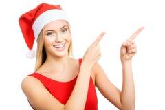 Santa girl shows a white space Stock Image