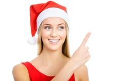 Santa girl shows a white space Royalty Free Stock Photo