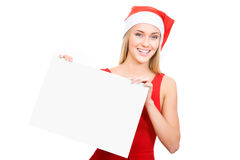 Santa girl shows a white space Royalty Free Stock Photography