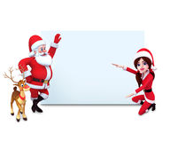 Santa girl is with sign and reindeer Stock Images