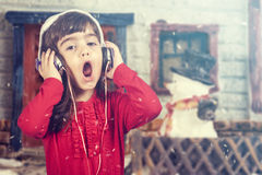 Santa girl singing Christmas carols Stock Photography