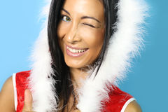 Santa girl smiling. Portrait of beautiful girl wearing santa claus clothes royalty free stock photography