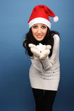Santa girl with snow Stock Photo
