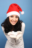 Santa girl with snow Stock Photography