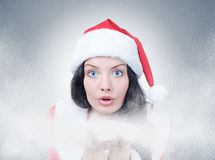 Santa Girl with snow Royalty Free Stock Photos