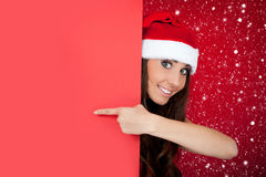 Santa girl in snow with blank billboard Royalty Free Stock Image