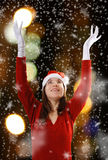 Santa girl snow and city lights Royalty Free Stock Photo