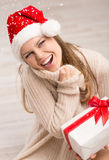 Santa girl and snowflakes Royalty Free Stock Photos