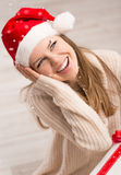 Santa girl and snowflakes Stock Images