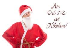 Santa Girl som ser till tysk text som isoleras på vit, begreppsst Royaltyfri Bild