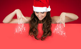 Santa girl sprinkling snow down Stock Photo