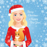 Santa girl with squirrel on blue Royalty Free Stock Images