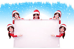 Santa girl is standing around a big sign Stock Photo