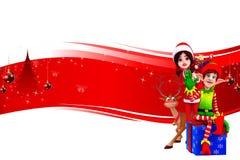 Santa girl standing behind elves Stock Photo
