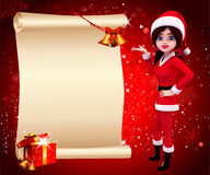 Santa girl standing near sign,red background Royalty Free Stock Photography