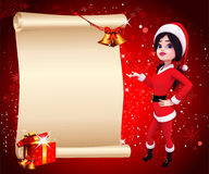 Santa girl standing with sign and red background Royalty Free Stock Photography
