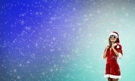 Santa girl in suit Stock Photos