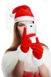 Santa girl taking photgraph Royalty Free Stock Photos