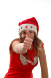 Santa girl with thumbs up royalty free stock image