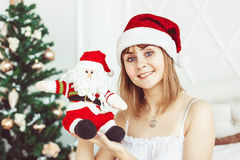 Santa girl with a toy stock photo