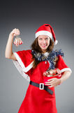 Santa girl with toys  on white Stock Photo