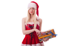 Santa girl is upset because of a bad gift Royalty Free Stock Photography