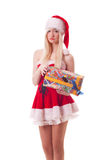 Santa girl is upset because of a bad gift Royalty Free Stock Photos