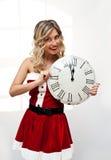 Santa girl with wall clock Royalty Free Stock Photography