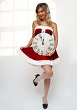 Santa girl with wall clock Stock Photo