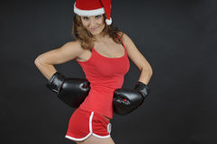 Santa girl  wearing boxing gloves Royalty Free Stock Photos
