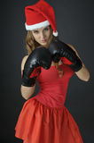 Santa girl  wearing boxing gloves Royalty Free Stock Photo