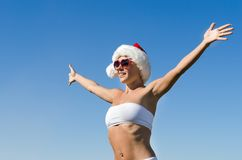 Santa girl wearing heart shaped sunglasses Stock Photo