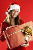 Santa Girl With A Big Present Royalty Free Stock Photos